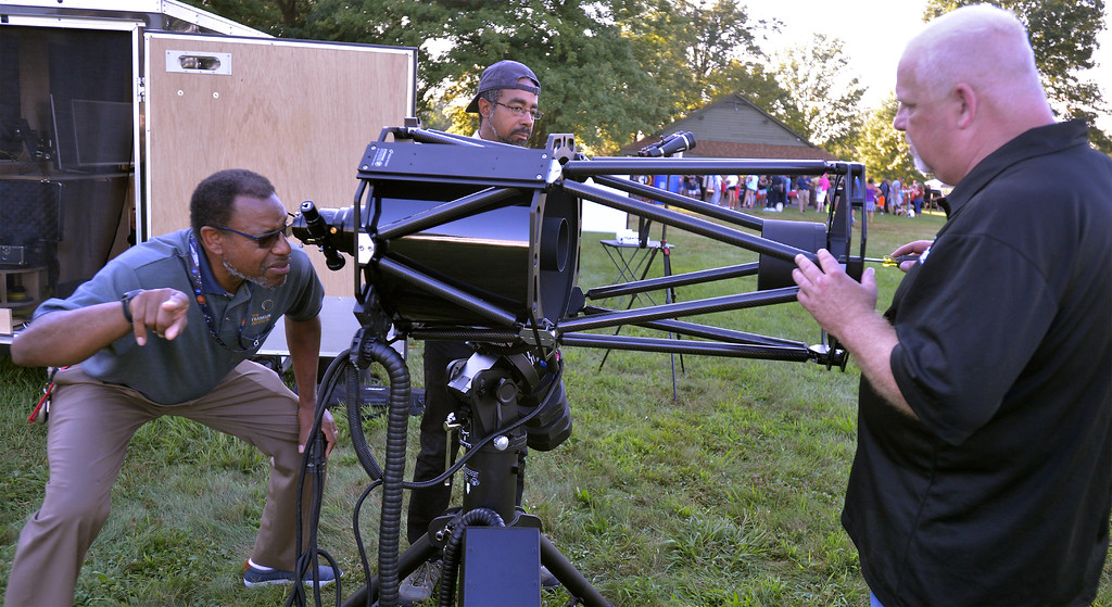 . Derrick Pitts, left, chief astronomist at the Franklin Institute, helps Ed Anderson, right, DarkSky on Demand, align the hyperbolic mirrors on a 14-inch RC telescope Aug 8, 2017. Also with DarkSky is Henry Naylor, center.  //  Bob Raines--Digital First Media