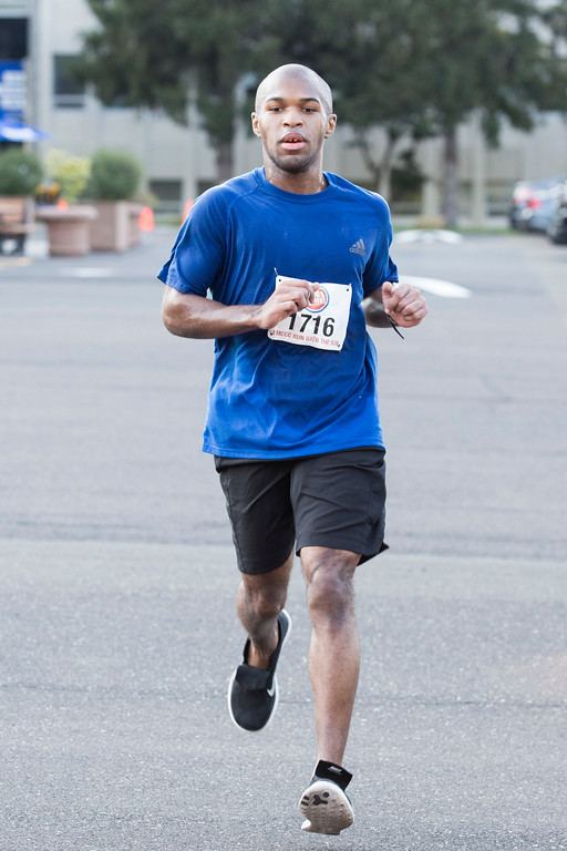. Warren Hayward, 24, finishes the Run in the Sun 5K in second place with a time of 19:22.  Rachel Wisniewski � For Digital First Media