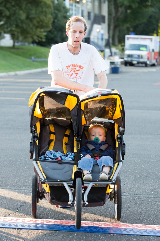 . Pat Hayburn, 32, finishes the 5K in third place with a time of 19:50 � all while pushing his son, Ricky, 2, in a double stroller.  Rachel Wisniewski � For Digital First Media