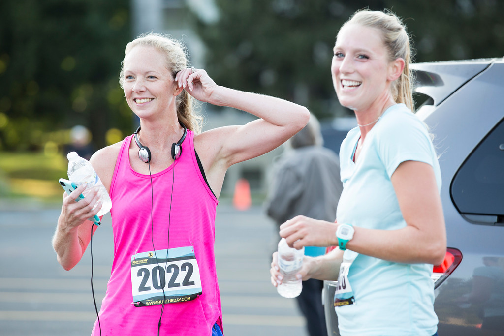 . Brooke Arnold, left, jokes around with Kiersten Moylan after they both finished the race. Arnold was the first woman to compete the race with a time of 21:51; Moylan was the second woman, with a time of 22:03.  Rachel Wisniewski � For Digital First Media