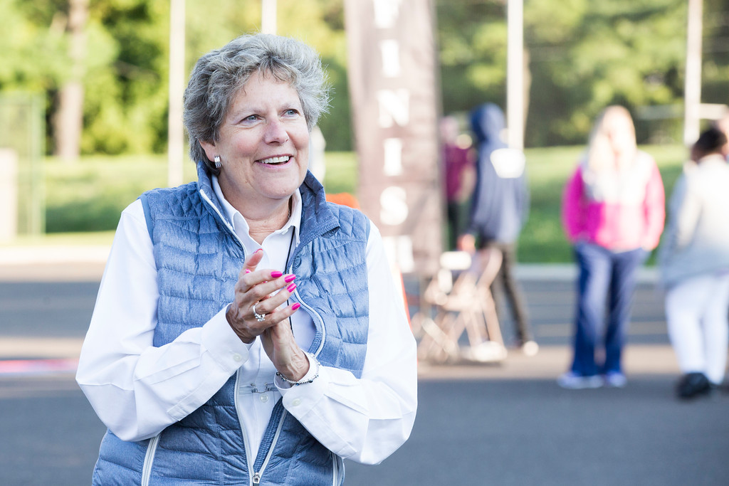 . Wendy Klinghoffer, executive director of the Eastern Montgomery County Chamber of Commerce, which organized the race, cheers on runners as they near the finish line.  Rachel Wisniewski � For Digital First Media