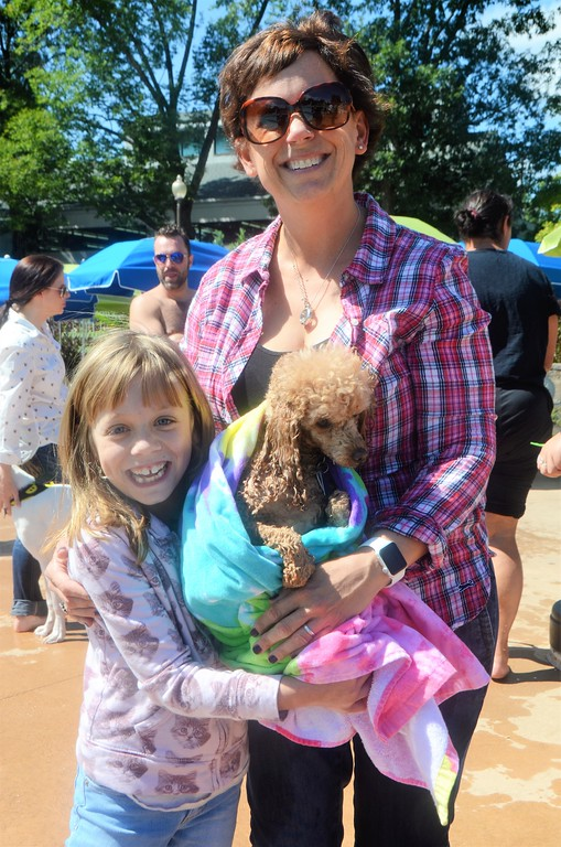 . Lisa Wilson and her daughter, Laura, brought their poodle, Penny, to Perkasie Borough Park and Recreation�s second annual Doggy Dip at the Menlo Aquatics Center Saturday, Sept. 9.  Christine Wolkin � For Digital First Media