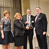 The Chamber of Commerce for Greater Montgomery County recognizes the Indian Creek Foundation with the Community Organization of the Year Award during its annual dinner and awards celebration at PineCrest Country Club Wednesday, Oct. 28. Left to right are Pam Kelly, chamber president; Sheri Strouse, chairman board of directors, Harleysville Bank; Brett Wells, Indian Creek Foundation; and Dan Reavy, board chairman.  Christine Wolkin — For Digital First Media