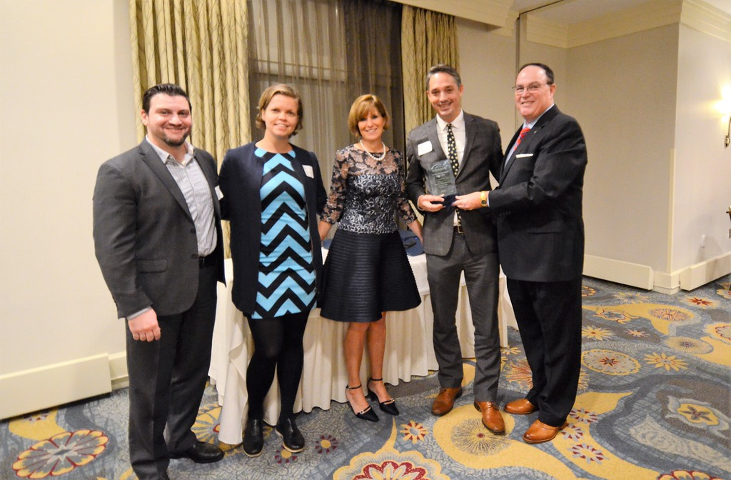 . The Chamber of Commerce for Greater Montgomery County awards Justin Weathers of Stove & Tap with the Young Entrepreneur of the Year Award during its annual dinner and awards celebration at PineCrest Country Club Wednesday, Oct. 28. Left to right are Marat Mamedov and Zsuzsa Palota, Boardroom Spirits LLC; Pam Kelly, chamber president; Weathers; and Dan Reavy, board chairman.  Christine Wolkin � For Digital First Media