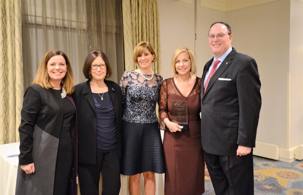 . The Chamber of Commerce for Greater Montgomery County awards Mary Griffith-Alfarano with the Community Service Award during its annual dinner and awards celebration at PineCrest Country Club Wednesday, Oct. 28. Left to right are Colleen Lelli and Beth Sturman, Laurel House; Pam Kelly, chamber president; Mary Griffith-Alfarano, Fulton Bank; and Dan Reavy, board chairman.  Christine Wolkin � For Digital First Media