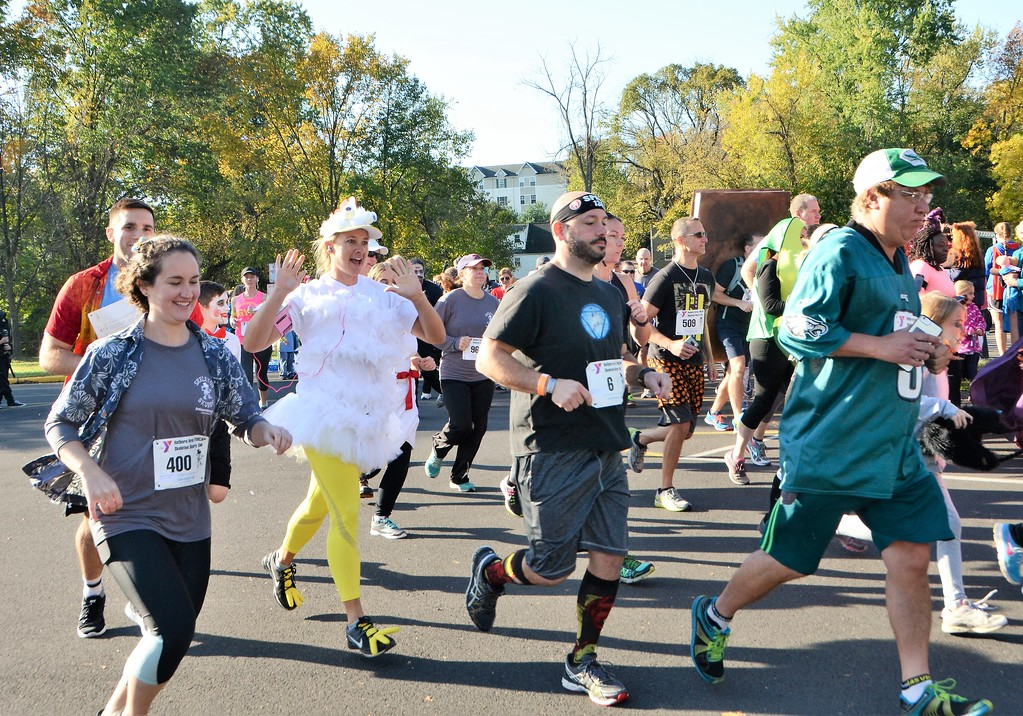 . Runners, many sporting Halloween costumes, participate in the 12th annual Independence Blue Cross Hatboro Area YMCA Skeleton Skurry 5K at Pennypack Elementary School in Hatboro Oct. 28. Christine Wolkin � For Digital First Media