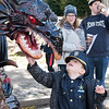Families partake in the myriad of activities and yummy treats provided by Ambler's businesses along East Butler Avenue during Ambler's Halloween Parade and Extravaganza Nov. 3. Christine Wolkin — For Digital First Media