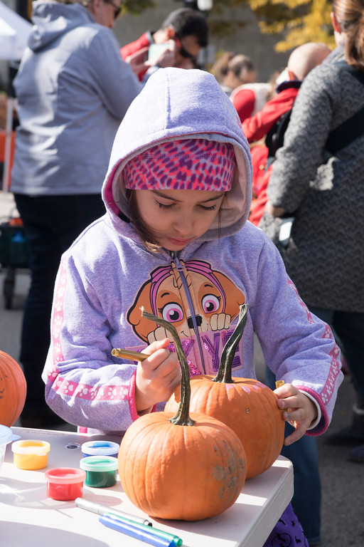 . Families partake in the myriad of activities and yummy treats provided by Ambler�s businesses along East Butler Avenue during Ambler�s Halloween Parade and Extravaganza Nov. 3. Christine Wolkin � For Digital First Media