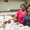 Bethlehem Baptist Church members package more than 250 Thanksgiving food baskets, which included turkeys, to be distributed to area families. Harrison Brink — For Digital First Media