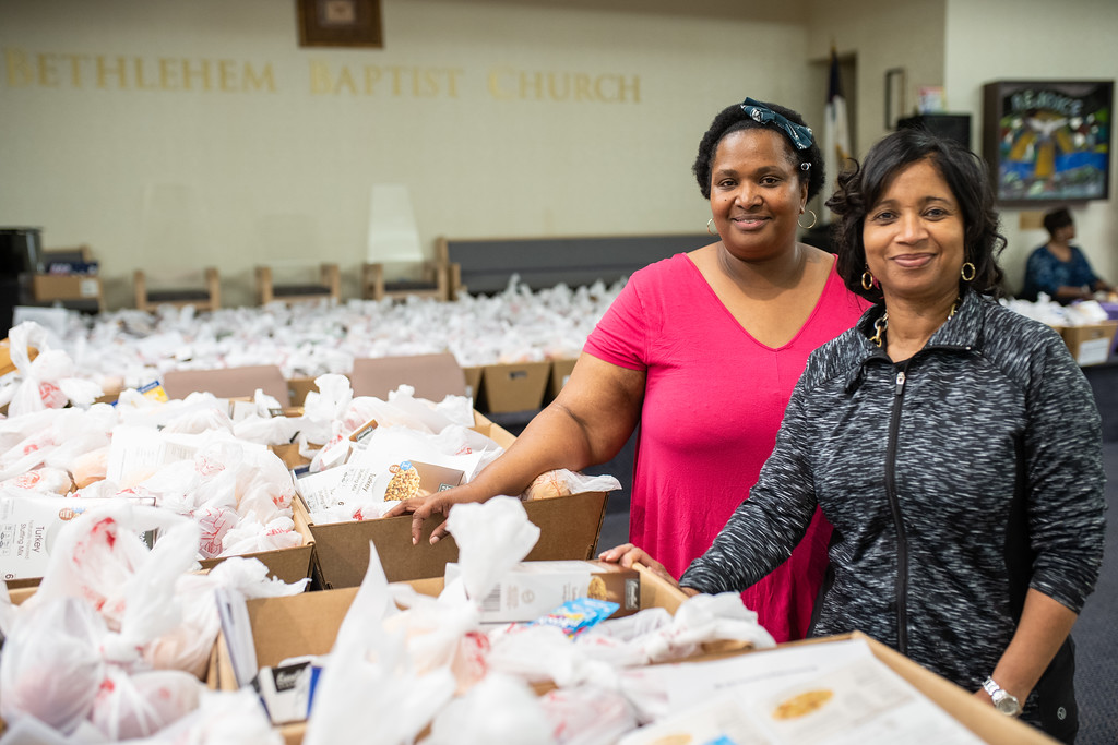 . Bethlehem Baptist Church members package more than 250 Thanksgiving food baskets, which included turkeys, to be distributed to area families. Harrison Brink � For Digital First Media