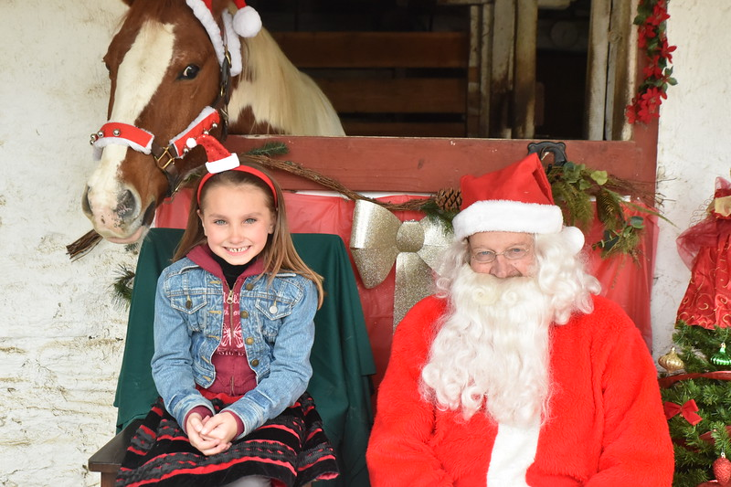 Santa pays an early visit to the Courtesy Stables in Andorra Saturday, Dec. 2. Children were able to pose with Santa and one of the horses that are housed at the stables. Rick Cawley - For Digital First Media