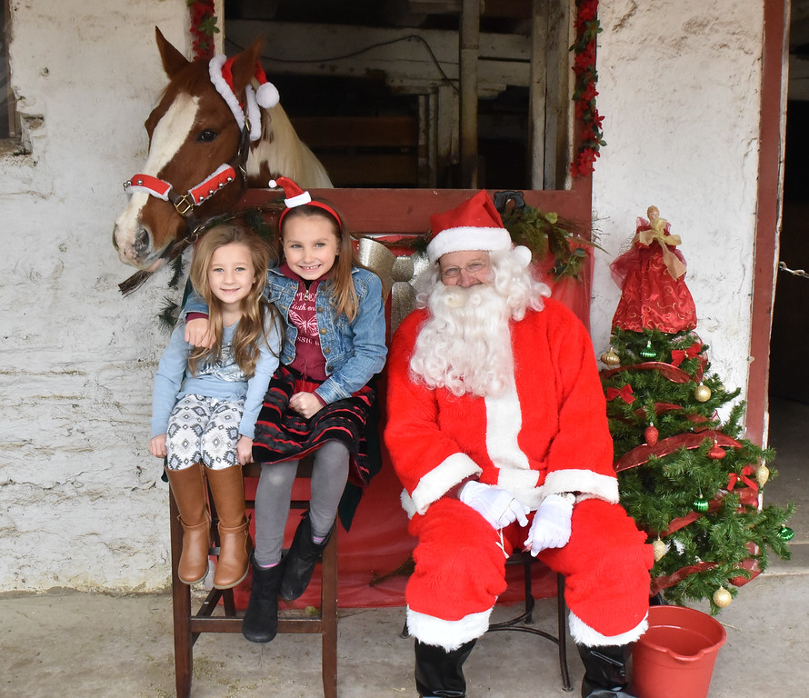 . Santa pays an early visit to the Courtesy Stables in Andorra Saturday, Dec. 2. Children were able to pose with Santa and one of the horses that are housed at the stables. Rick Cawley - For Digital First Media