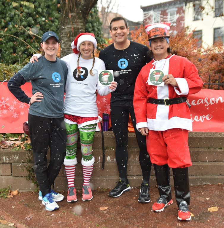 . Festively dressed runners participate in the annual Rudolph Run sponsored by Philadelphia Runner, which commenced and finished at Canal View Park on Main Street in Manayunk, Saturday, Dec. 9. Rick Cawley - For Digital First