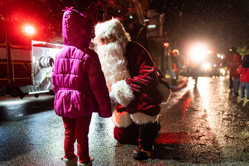 Santa visits with local youngsters during the Erdenheim Civic Association's 16th annual Santa Run Dec. 16. Riding on a fire truck, St. Nick made stops throughout the neighborhood and visited with local children ahead of his return trip Dec. 25. Harrison Brink — For Digital First Media