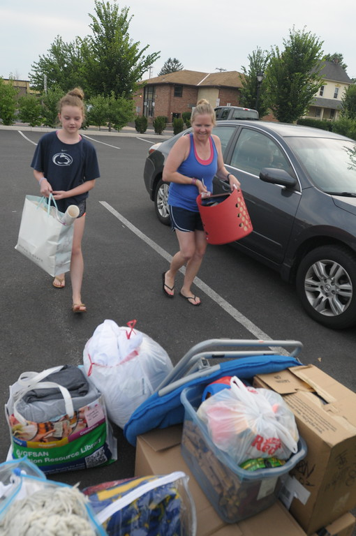 . Sara Sanders receives donations from area residents as she and her children transitions from a homeless shelter to her own apartment July 21, 2017. Gene Walsh � Digital First Media