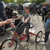 """Montgomery Count's District Attorney's office """"Wheels of Justice""""  and """"G-Riders"""" team up to donate specially fitted bicycles to children with special needs in Abington May 10, 2017. Gene Walsh — Digital First Media"""