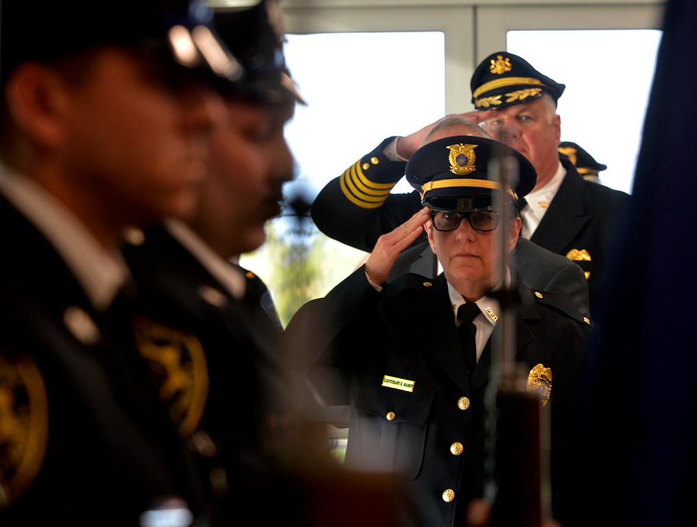 . Police officials salute as the police color guard presents the colors at the Victim Services Center Annual Candlelight Vigil April 11, 2017.  (Bob Raines--Digital First Media)