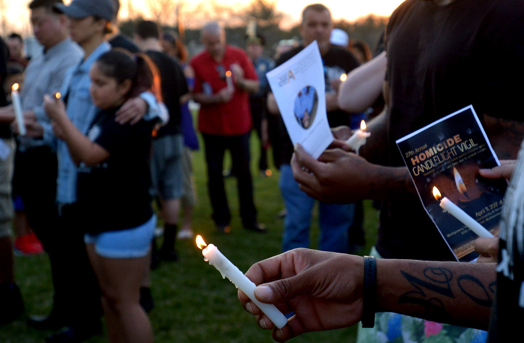 . Family and friends hold lighted candles in remembrance of those lost to violence  April 11, 2017.  (Bob Raines--Digital First Media)