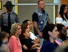 Family and friends listen solemnly as the list of murder victims is read April 11, 2017.  (Bob Raines--Digital First Media)