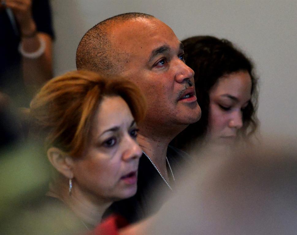 ". Linda and Robert Braxton, parents of murder victim Robert Braxton III, listen to, \""Amazing Grace,\"" April 11, 2017.  (Bob Raines--Digital First Media)"