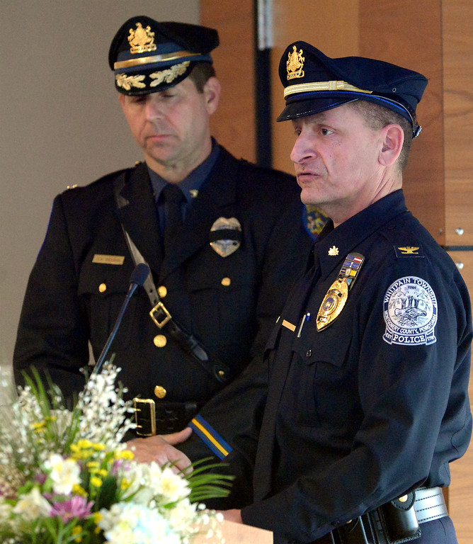 . Chief Kenneth Lawson, right, Whitpain Police Department, and Chief Scott Bendig, Montgomery Police Department, read the Law Enforcement Honor Roll April 11, 2017.