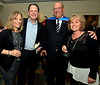 Janet Whitehead, left, Ron Flaherty, Superhero Scott Clemens and Diane Clemens enjoy the North Penn United Way Superheroes Unite Gala April 21, 2017.  (Bob Raines/Digital First Media)
