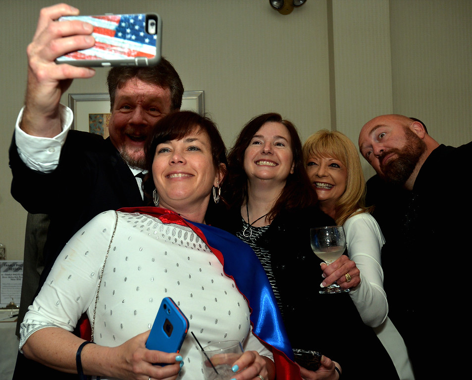 . Jim Garrahan takes a selfie of Superhero Theresa Schwartzer, Cheryl Gillmer, Tonja Garrahan and Greg Schwartzer at the North Penn UnitedWay Superheroes Unite Gala April 21, 2017.  (Bob Raines/Digital First Media)