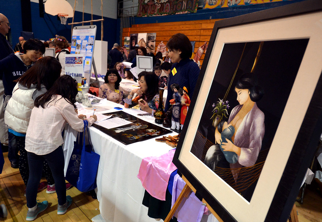 . Children stop at the Vietnam table during the International Spring Festival at North Penn High School April 22, 2017.  (Bob Raines/Digital First Media)
