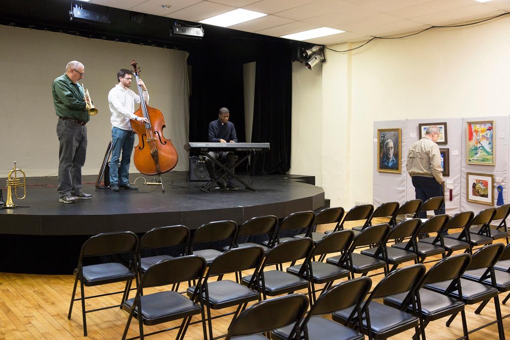 . Jazplash, a jazz trio featuring (from left) Ed Neiderhiser, Tim Wolfe, and Jarred Alston, plays a set at the exhibition. (Rachel Wisniewski/For Digital First Media)