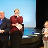 Caroline Reid (right), the winner of the G1: grades K-4 portion of the Junior Artists Awards is giddy as she receives her award from Ed Kane and Rhonda Garland. (Rachel Wisniewski/For Digital First Media)