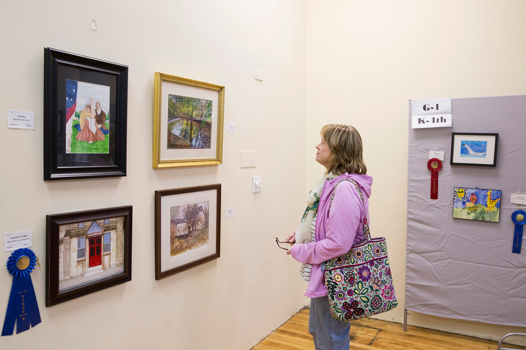 . Jo Thompson Pennypacker, a former member of the North Penn Arts Alliance, strolls around the upstairs portion of the Creative Edge Center for the Arts and views the artwork on display. (Rachel Wisniewski/For Digital First Media)
