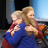 Rhonda Garland, the current Exhibition Chair, hugs Barbara Moss Buscher, the former Exhibition Chair who founded the Members' Exhibition 22 years ago. (Rachel Wisniewski/For Digital First Media)