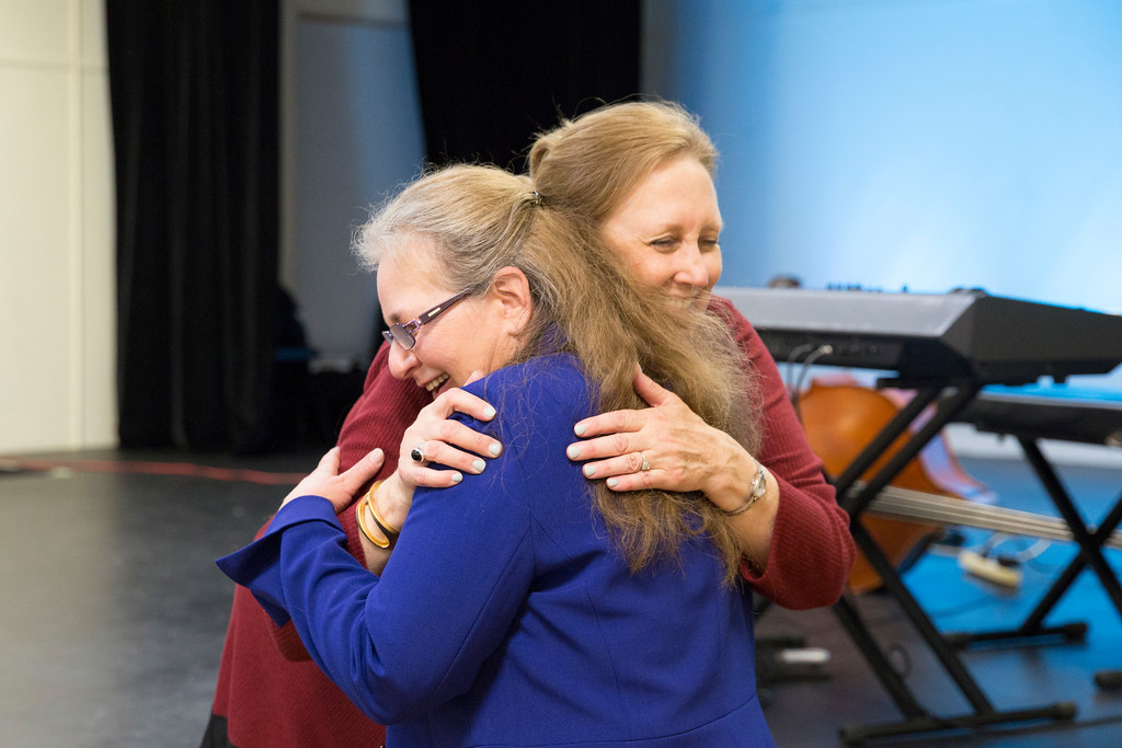 . Rhonda Garland, the current Exhibition Chair, hugs Barbara Moss Buscher, the former Exhibition Chair who founded the Members� Exhibition 22 years ago. (Rachel Wisniewski/For Digital First Media)