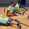 Boys and girls have fun on floor scooters at the Montgomery Elementary MiniTHON Feb. 4, 2017.  (Bob Raines--Digital First Media)