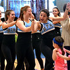 Members of the North Penn High School Dance Team pass another section of a long dance chain snaking around the gym at the Montgomery Elementary MiniTHON Feb. 4, 2017.  (Bob Raines--Digital First Media)