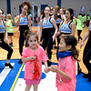 Two girls dance along with the North Penn High School Dance Team at the Montgomery Elementary MiniTHON Feb. 4, 2017.  (Bob Raines--Digital First Media)