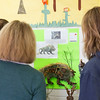 Pennsylvania Horticultural Society judges admire the crafty creature that fourth-grader Ayden Kane assembled.  Rachel Wisniewski — For Digital First Media