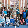 A fifth-grade class gathers around the windmill they collectively created from recycled materials.  Rachel Wisniewski — For Digital First Media