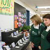 Pennsylvania Horticultural Society volunteer Renee Meister, right, admires the artwork and plants submitted by Highland Elementary Students in the Junior Flower Show Feb. 15.  Rachel Wisniewski — For Digital First Media