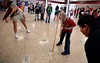 """Emily Marino and Matt Richman try to knock over water bottles wearing pantyhose loaded with a tennis ball as the play """"Elephant Trunk""""during LOG-A-THON at Log College Middle School Feb. 23, 2017.  (Bob Raines--Digital First Media)"""