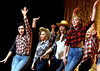 """Rusty (Liz Jones), front left, Ariel (Jessica Stahl), front right, and the dance ensemble rehearse """"Let's Hear It for the Boy"""" for the Upper Moreland High School production, """"Footloose,"""" March 22, 2017.  (Bob Raines / Digital First Media)"""