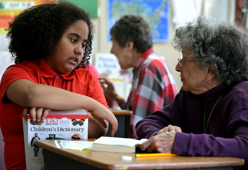 Elias Chernoff, left, talks with his Reading Buddy, Doranne Smith, about a word he couldn't find in his dictionary at Center School, Abington April 4, 2017.  (Bob Raines / Digital First Media)