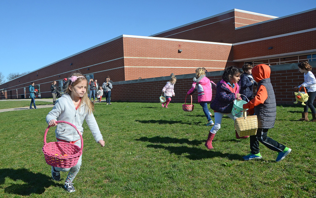 . Children race for Easter eggs during the Future Business Leaders of America�s annual egg hunt at Souderton Area High School Saturday, April 8.  Christine Wolkin � For Digital First Media