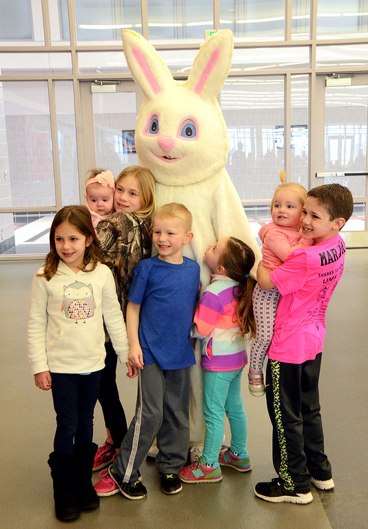 . Children say hello to the Easter Bunny during the Future Business Leaders of America�s annual egg hunt at Souderton Area High School Saturday, April 8.  Christine Wolkin � For Digital First Media