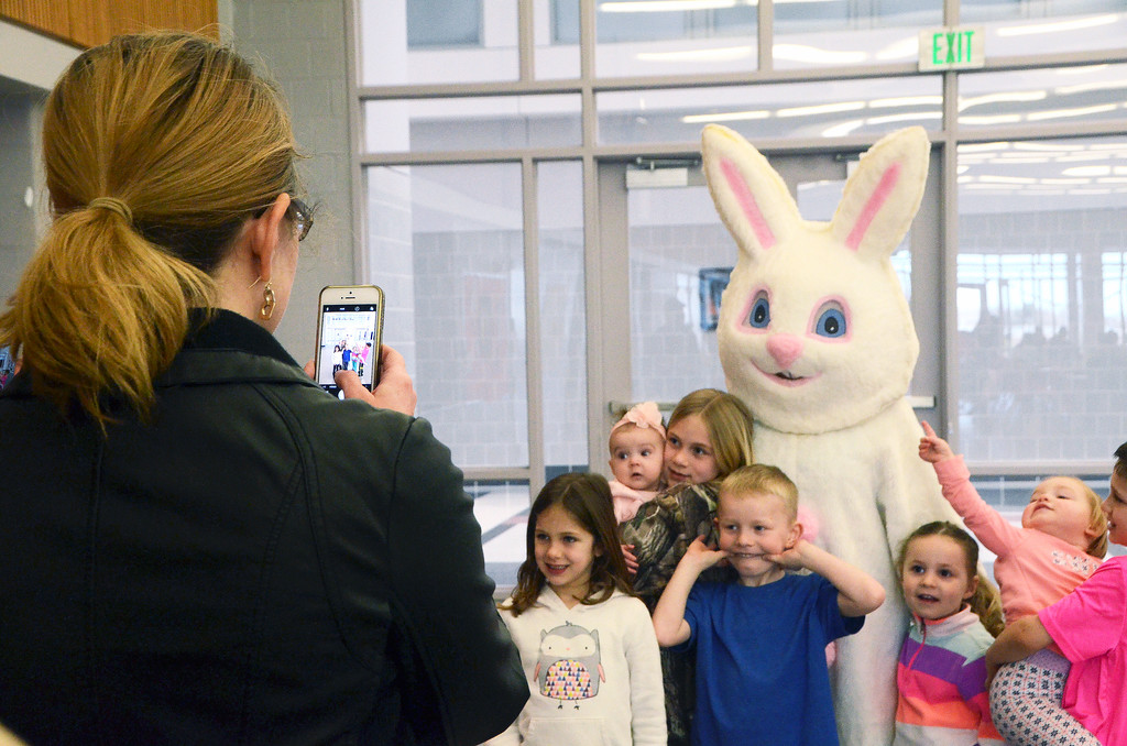 . Parents take photos of their children as they meet the Easter Bunny during the Future Business Leaders of America�s annual egg hunt at Souderton Area High School Saturday, April 8.  Christine Wolkin � For Digital First Media