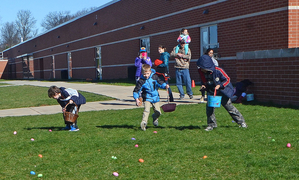 . Children scramble for Easter eggs during the Future Business Leaders of America�s annual egg hunt at Souderton Area High School Saturday, April 8.  Christine Wolkin � For Digital First Media