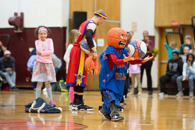 Young audience members partake in a relay race at halftime in which they had to dress themselves in a large pair of basketball shorts, a jersey and a basketball mask before dribbling a ball down the court.  Rachel Wisniewski — For Digital First Media