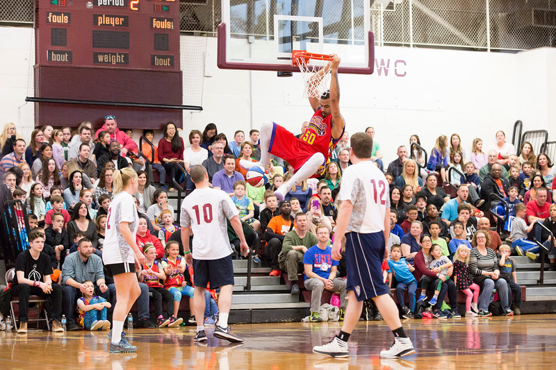 """""""The Mauler"""" scores a slam dunk for the Harlem Wizards in the second period of the game.  Rachel Wisniewski — For Digital First Media"""