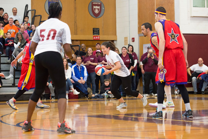 Mary Corbo, a teacher at McKinley Elementary School, dribbles the ball down the Abington High School basketball court.  Rachel Wisniewski — For Digital First Media