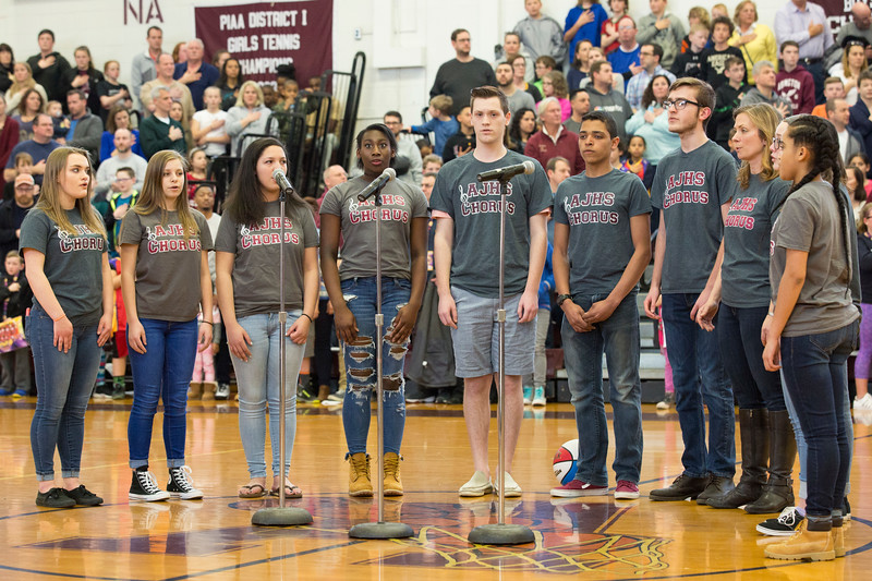 The Abington Junior High School Chorus sings the national anthem to kick off the Harlem Wizards vs. Abington basketball game April 8. All funds raised went to the Abington Educational Foundation to provide student laptops for the Abington School District.  Rachel Wisniewski — For Digital First Media